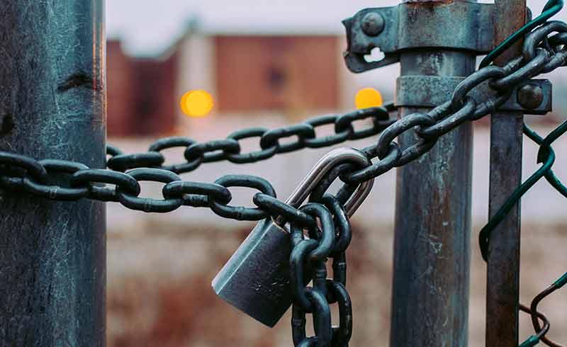Security pad lock on fence